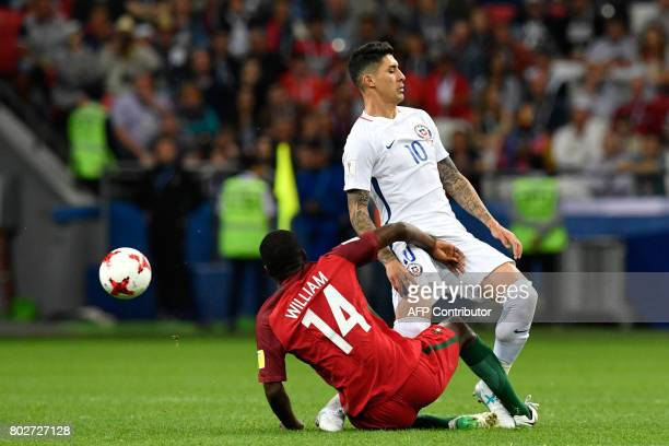 Portugal's midfielder William vies with Chile's midfielder Pablo Hernandez during the 2017 Confederations Cup semifinal football match between...