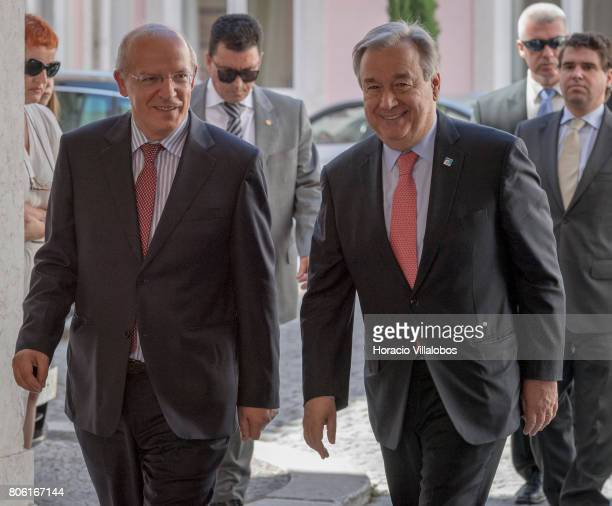Portugal's Minister of Foreign Affairs Augusto Santos Silva greets UN Secretary General Antonio Guterres in Necessidades Palace headquarters of the...
