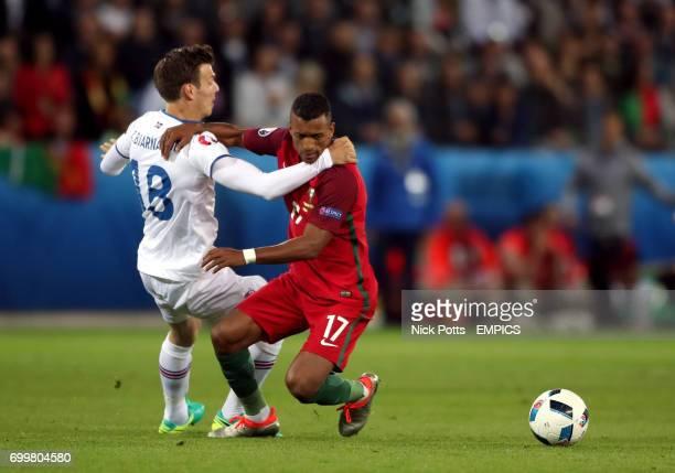 Portugal's Nani and Iceland's Theodor Elmar Bjarnason battle for the ball