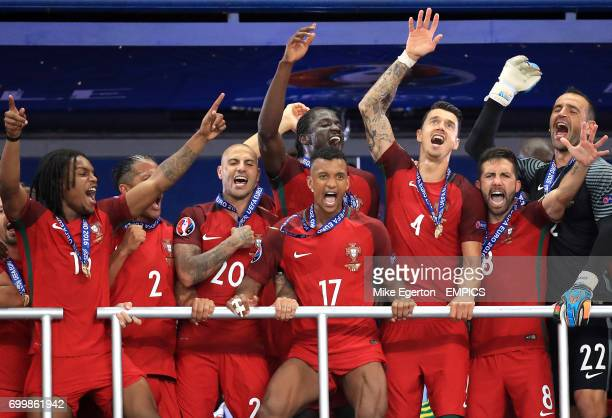 Portugal's Nani celebrates with teammates on the balcony as they lift The Henri Delaunay Cup