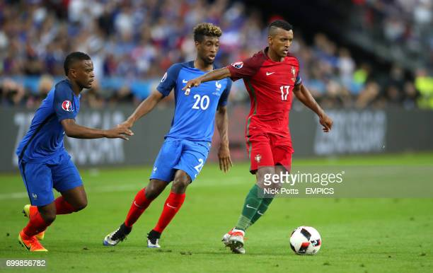 Portugal's Nani holds off France's Kingsley Coman and Patriec Evra