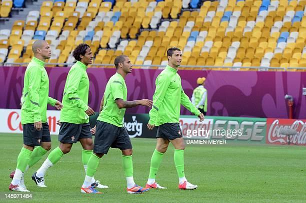 Portugal's national football team defender Pepe defender Bruno Alves midfielder Ricardo Quaresma and forward Cristiano Ronaldo attend a training...