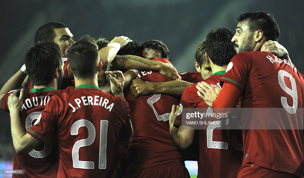 Portugal's national football team players celebrate after scoring a goal against Azerbaijan's national football team during their 2014 World Cup qualifying football match at Tofig Bahramov stadium in the Azerbaijan's capital Baku, on March 26, 2013. AFP PHOTO / VANO SHLAMOV