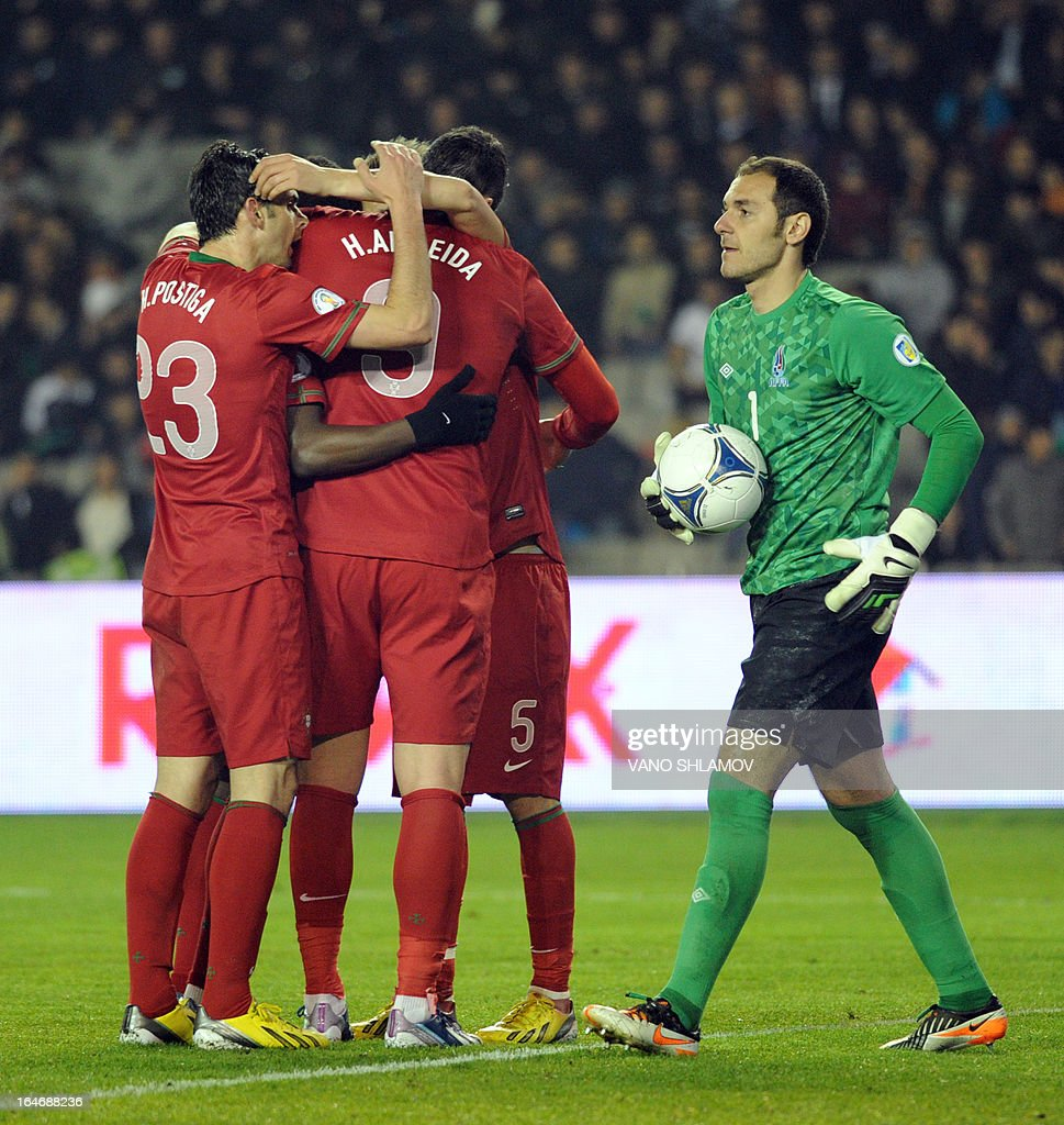 Portugal's national football team players celebrate after scoring a goal against Azerbaijan's national football team during their 2014 World Cup qualifying football match at Tofig Bahramov stadium in the Azerbaijan's capital Baku, on March 26, 2013.