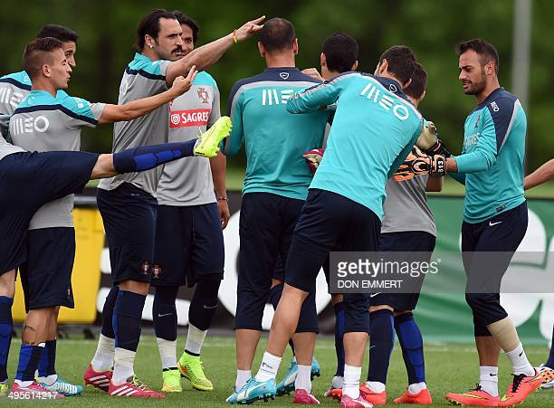 Portugal's national team players clown around during training June 4 2014 in Florham Park New Jersey Portugal made a stop in the US for training and...