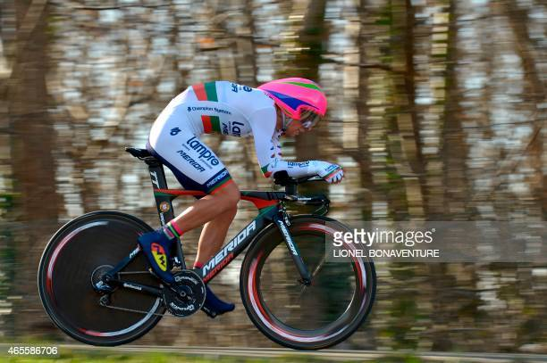 Portugal's Nelson Oliveira competes during the 67 km individual timetrial and prologue of the 73rd edition of the ParisNice cycling race on March 8...