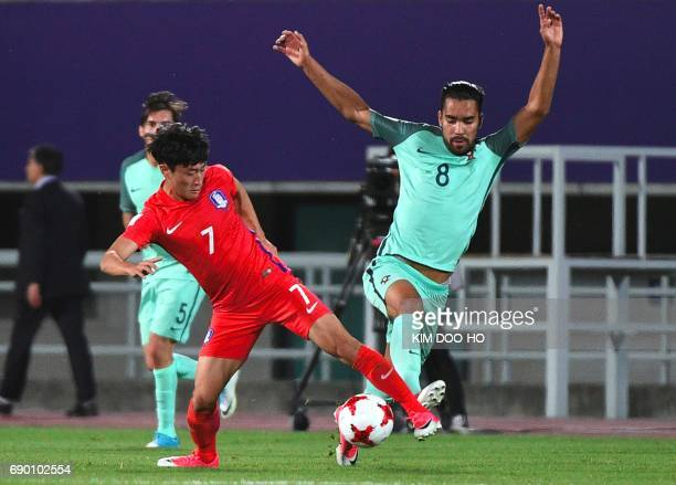 Portugal's Pedro Delgado fights for the ball with South Korea's Lee JinHyun during the FIFA Under 20 World Cup round of 16 football match in Cheonan...