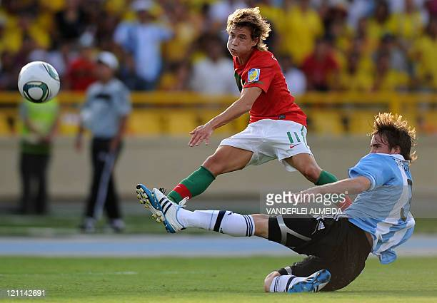 Portugal´s player Rui Caetano vies for the ball with Nicolas Tagliafico of Argentina during their FIFA World Cup U20 football match at Jaime Moron...