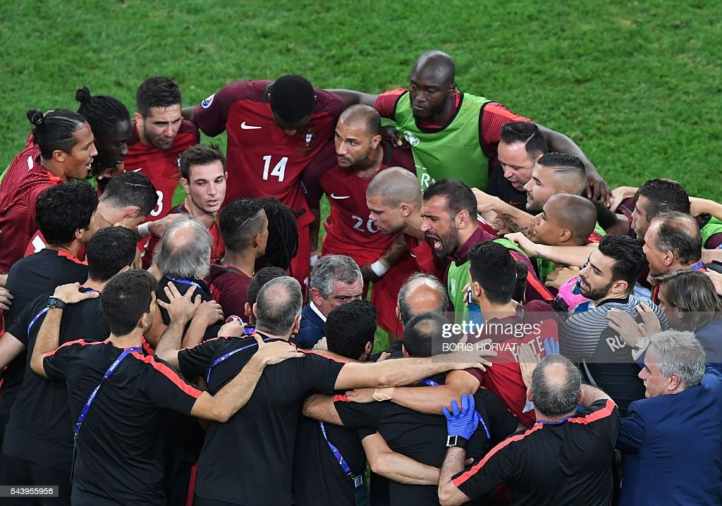Portugal's players and teammates cheer each other prior to overtime during the Euro 2016 quarter-final football match between Poland and Portugal at the Stade Velodrome in Marseille on June 30, 2016. / AFP / BORIS