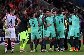 Portugal's players celebrate after the round of sixteen football match Croatia against Portugal of the Euro 2016 football tournament on June 25 2016...