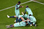 TOPSHOT Portugal's players celebrate at the end of the Euro 2016 round of sixteen football match Croatia vs Portugal on June 25 2016 at the...