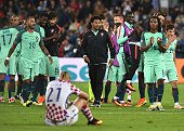 Portugal's players celebrate at the end of the extratime in the Euro 2016 round of sixteen football match Croatia vs Portugal on June 25 2016 at the...