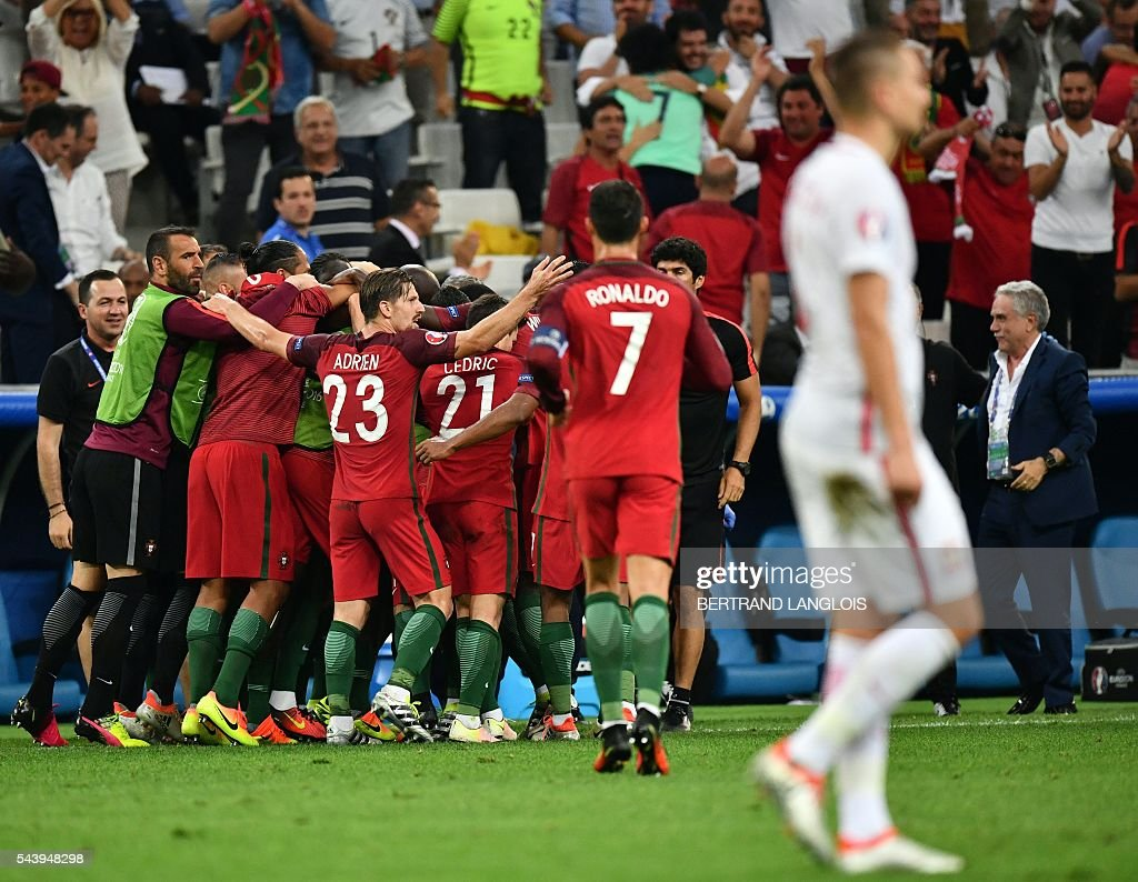 Portugal's players celebrate scoring their first goal during the Euro 2016 quarter-final football match between Poland and Portugal at the Stade Velodrome in Marseille on June 30, 2016. / AFP / BERTRAND