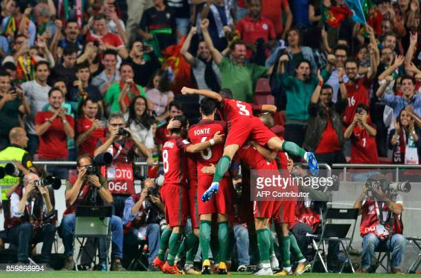 Portugals players celebrate their team's second goal during the FIFA World Cup 2018 Group B qualifier football match between Portugal and Switzerland...