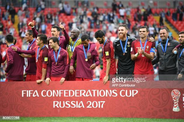 Portugal's players celebrate with their bronze medals at the end of the 2017 FIFA Confederations Cup third place football match between Portugal and...
