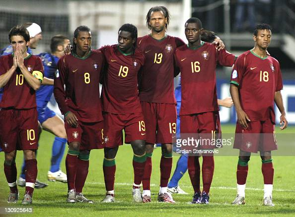 Portugal's players from left Joao Moutinho Manuel Fernandes Silvestre Varela Rolando Joao Moreira and Nani is dejected after they lost match against...