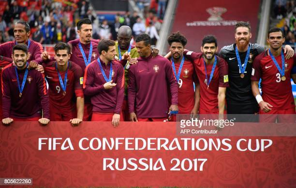 TOPSHOT Portugal's players pose with their bronze medals at the end of the 2017 FIFA Confederations Cup third place football match between Portugal...