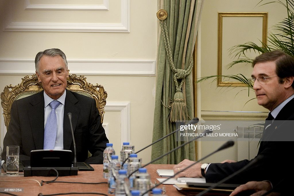 Portugal's President Anibal Cavaco Silva (L), flanked by Portuguese Prime Minister Pedro Passos Coelho (R), chairs a state council meeting at the Belem Palace in Lisbon on July 3, 2014. Portugal emerged on May 17 from a three-year bailout programme supervised by the European Union and International Monetary Fund. The centre-right government aims to lower the country's annual public deficit to the equivalent of 4.0 percent of total economic output by the end of this year from 4.9 percent in 2013.