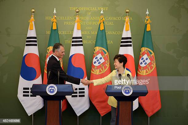 Portugal's President Anibal Cavaco Silva shakes hands with South Korea's President Park GeunHye following a press conference at the presidential Blue...