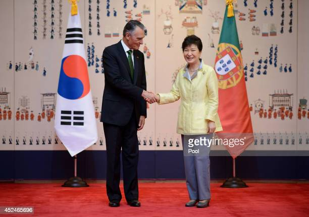 Portugal's President Anibal Cavaco Silva shakes hands with South Korea's President Park GeunHye before their meeting at the presidential Blue House...