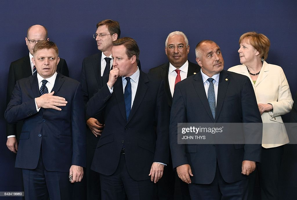 Portugal's Prime minister Antonio Costa, Czech Republic's Prime minister Bohuslav Sobotka, Slovenia's Prime minister Miro Cerar, Germany's Chancellor Angela Merkel, (First Row, from L) Slovakian Prime minister Robert Fico, Britain Prime minister David Cameron and Bulgarian Prime minister Rosen Plevneliev pose for a family picture during EU - Summit at the EU headquarters in Brussels on June 28, 2016. Prime Minister David Cameron said Tuesday he wants the 'closest possible' relations with the EU after Britain voted to leave the bloc, adding the split should be 'as constructive as possible'. As he arrived at a Brussels summit, Cameron, who is to step down within weeks, told reporters that, while Britain was leaving the EU, 'we mustn't be turning our backs on Europe.' THYS