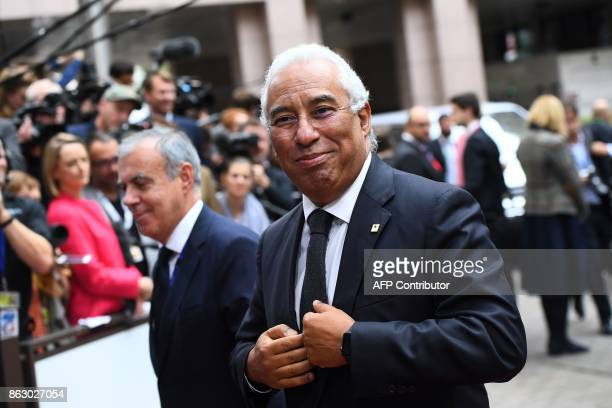 Portugal's Prime minister Antonio Costa looks on as he arrives in Brussels on October 19 2017 on the first day of a summit of European Union leaders...