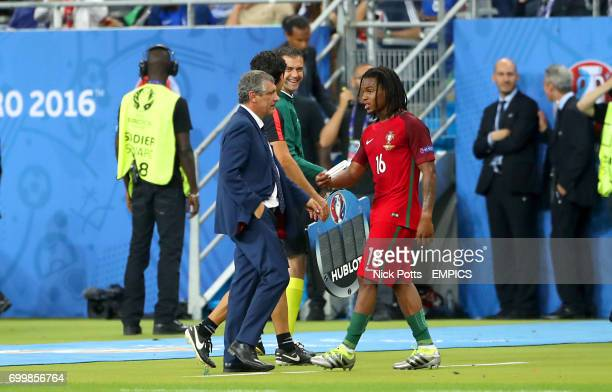 Portugal's Renato Sanches is substituted off by Portugal manager Fernando Santos