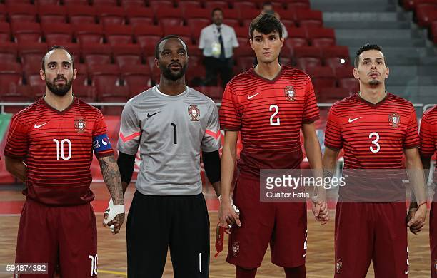 Portugal's Ricardinho with Portugal's goalkeeper Bebe and Portugal's Andre Coelho and Portugal's Bruno Coelho during the National Anthem before the...