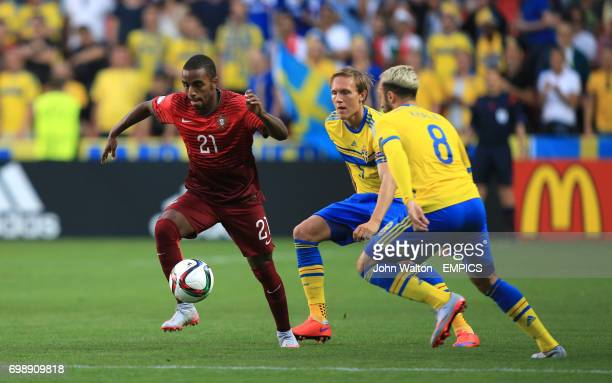 Portugal's Ricardo Pereira gets away from Sweden's Ludwig Augustinsson and Abdul Khalili