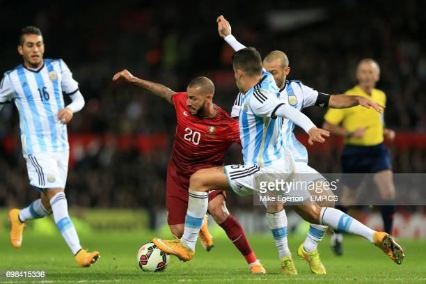 Portugal's Ricardo Quaresma and Argentina's Martn Demichelis battle for the ball