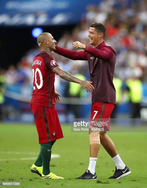 Portugal's Ricardo Quaresma and Portugal's Cristiano Ronaldo embrace after their side won the UEFA Euro 2016 final