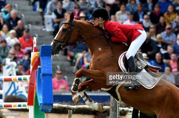 Portugal's rider Luciana Diniz with her horse FitForFun 13 jumps over an obstacle during the Grand Prix of Aachen during the World Equestrian...