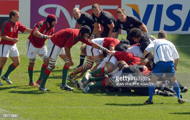 Portugal's Rui Cordeiro is tackled by New Zealand's number 8 Sione Lauaki and teammates while scoring a try during their rugby union World Cup group...