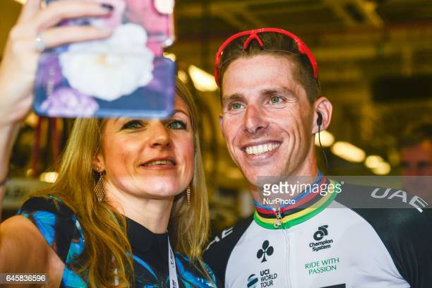 Portugal's Rui Costa from UAE Emirates Team poses for a selfie with a fan ahead of the fourth stage a 143km Yas Island Stage at the F1 Yas Marina...