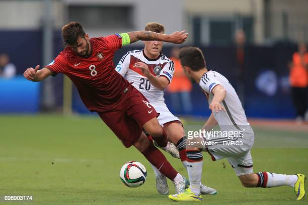 Portugal's Sergio Oliveira and Germany's Julian Korb battle for the ball
