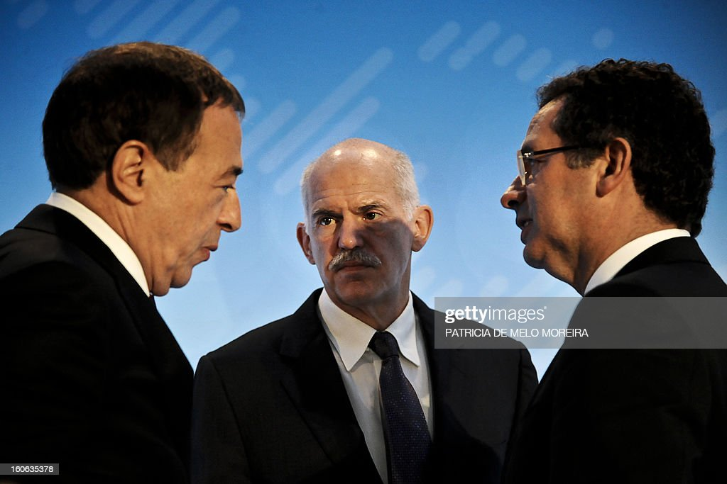 Portugal's Socialist Party leader Antonio Jose Seguro (R) speaks with Former Greek Prime Minister and President of the Socialist International (SI) George Papandreou and secretary-general of the SI Luis Ayala (R) during the Council of the Socialist International in Cascais on February 4, 2013. The Socialist International is a worldwide association of social democratic, socialist and labour parties.