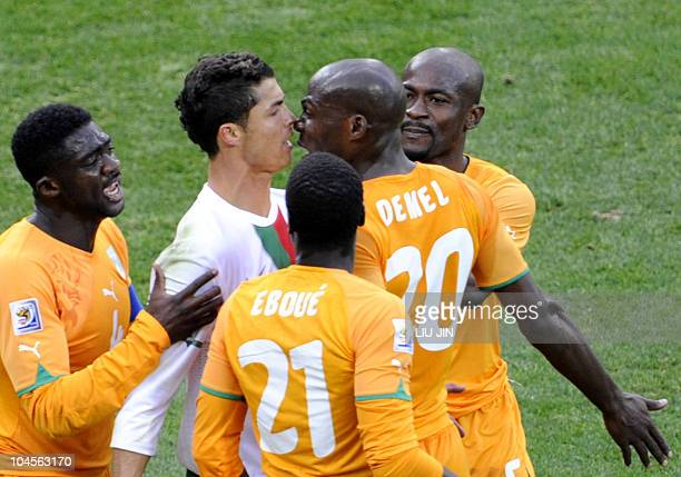 Portugal's striker Cristiano Ronaldo argues with Ivory Coast's defender Guy Demel during the Group G first round 2010 World Cup football match Ivory...