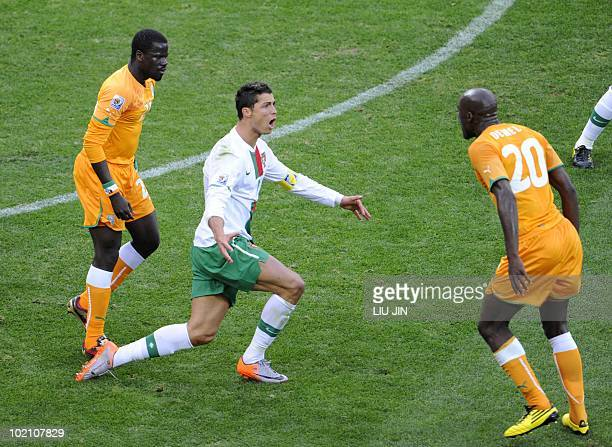 Portugal's striker Cristiano Ronaldo complains after being tackled by Ivory Coast's defender Guy Demel during the Group G first round 2010 World Cup...