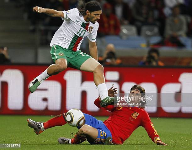 Portugal's striker Danny jumps over Spain's defender Sergio Ramos during their 2010 World Cup round of 16 football match at Green Point stadium in...