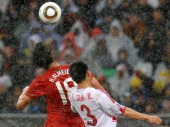 Portugal's striker Hugo Almeida fights for the ball with North Korea's defender Ri JunIl during the Group G first round 2010 World Cup football match...