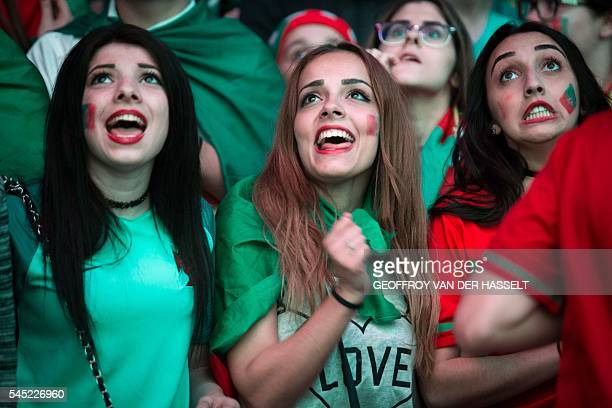 Portugal's supporters react as they watch on a giant screen the Euro 2016 semi final football match between Portugal and Wales at the fan zone of the...