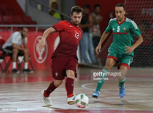 PortugalÕs Tiago Brito with MoroccoÕs Youssef El Mazray in action during the Futsal International Friendly match between Portugal and Morocco at...