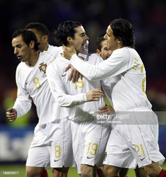 Portugal's Tiago Mendes celebrate after scoring the goal with his teammates Armando Teixeira and Nuno Gomes against Serbia during their Euro 2008...