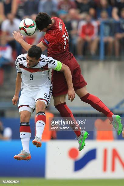 Portugal's Tobias Figueiredo and Germany's Kevin Volland battle for the ball in the air