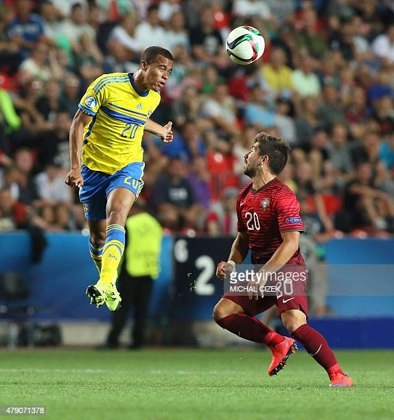 Portugal's Toze and Sweden's Robin Quaison vie for the ball during the UEFA Under 21 European Championship 2015 final football match between Sweden...