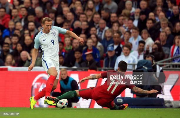 Portugal's Vieirinha tackles England's Harry Kane