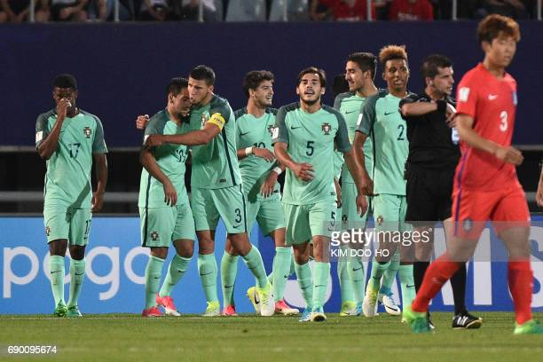 Portugal's Xadas celebrates his goal with teammates during their U20 World Cup round of 16 football match between South Korea and Portugal in Cheonan...