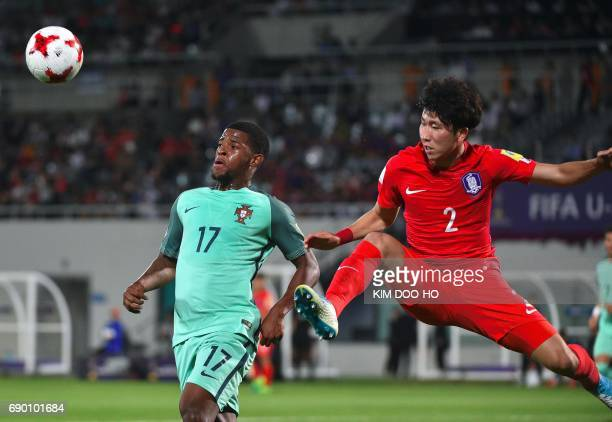 Portugal's Xande Silva fights for the ball with South Korea's Yoon JongGyu during the FIFA Under 20 World Cup round of 16 football match in Cheonan...