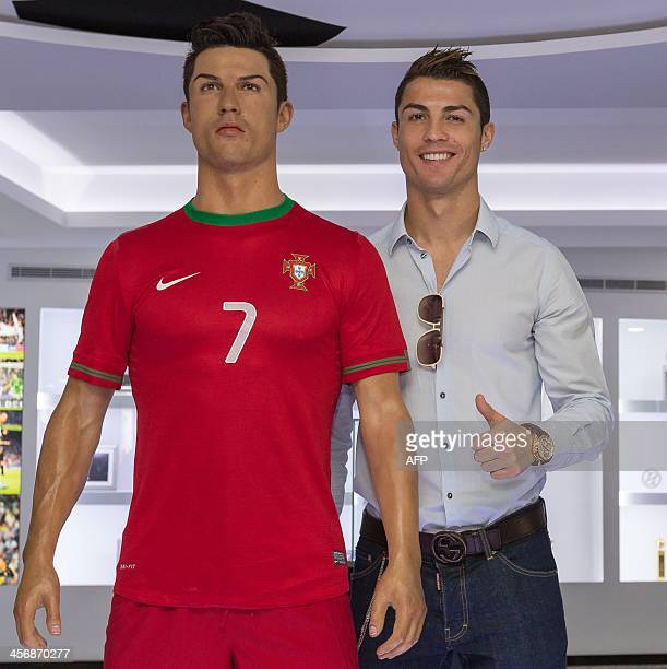 Portugese footballer and current country captain Cristiano Ronaldo poses beside a wax statue of himself during a the inauguration of the CR7 museum...