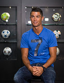Portugese forward Cristiano Ronaldo poses during a visit to the new location of the CR7 museum dedicated his professional career at Funchal on the...